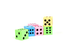 Colorful dices. Isolated on a white background stock photos