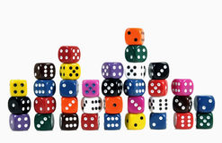 Colorful dices. Colorful casino dices in vertical stacks on white background stock image