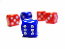 Colorful dices. Closeup of red and blue dices on white background stock photo