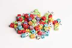 Colorful dices. Pile of dices of various colors Stock Image