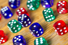 Colorful dices background on wood Royalty Free Stock Image