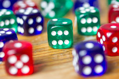 Colorful dices background on wood Stock Photo