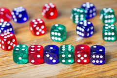 Colorful dices background on wood Royalty Free Stock Images