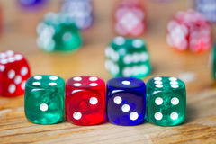 Colorful dices background on wood Stock Image
