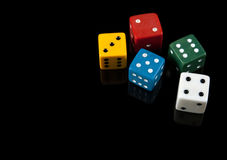 Colorful dices on black background stock photos