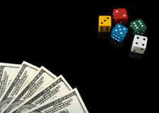 Colorful dices and money on black background stock photography