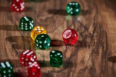 colorful dices in motion on wooden background royalty free stock images