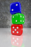 Colorful dices. Red, green and blue dices one on another on the shining plane, 3d rendering Royalty Free Stock Photo