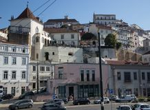 Colorful and different buildings of Coimbra in downtown. Buildings of downtown of Coimbra on the different levels above the ground stock photo