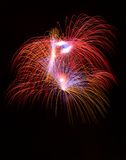 Colorful different colors, amazing fireworks in Malta, dark sky background and house light in the far, Independence day, fireworks. Explode close up Royalty Free Stock Images