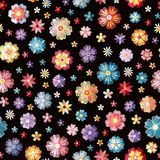 Colorful different embroidered flowers on black background. Vector seamless pattern. Floral embroidery.  royalty free illustration