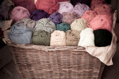 Colorful different wool thread balls in wicker basket Stock Photos