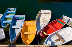 Colorful Dinghies. Tied up at a dock Royalty Free Stock Photo