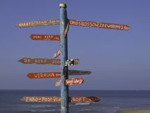 Colorful direction indicator on the beach royalty free stock photography