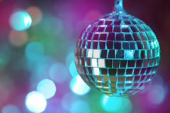 Colorful disco ball on bokeh background - horizontal Stock Images