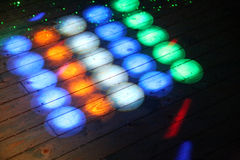 Colorful disco lights on the dance floor at a discotheque without people Stock Photography