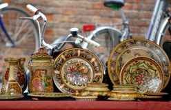 Colorful dishes and bikes Stock Image