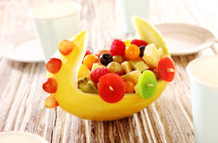 Colorful display of fresh fruit salad in a boat Stock Photo