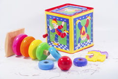 Colorful display of jack-in-the-box, teething rings, and stacking donuts. Royalty Free Stock Photography