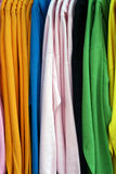 Colorful display on shirts hanging on a rack Stock Photo