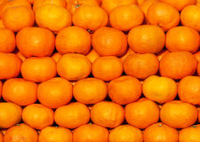 A colorful display of stacked fresh mandarines. A colorful display of stacked fresh mandarin oranges on a local market in Croatia Stock Photo