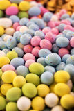 Colorful display of sugared chocolate Easter eggs. Colorful display of sugar-coated chocolate Easter eggs in a variety of colors viewed low angle with shallow royalty free stock photography