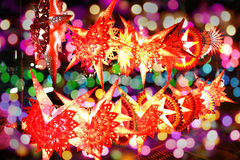 Colorful Diwali. Beautiful lit traditional skylanterns on the backdrop of colorful lights, on the occassion of Diwali festival in India Stock Photos
