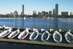 Colorful docked sailboats and Boston Skyline in winter on half frozen Charles River, Massachusetts, USA Stock Images
