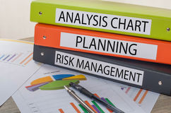 Colorful document binders. With the label Analysis chart,Planning,Risk management stock photo