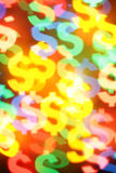Colorful dollar symbols. Colorful blurred dollar symbols, may be used as background Royalty Free Stock Photo