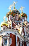 Colorful domes church Nativity of Most Holy Mother God Stock Photos