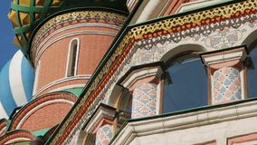 St Basil`s Cathedral in Moscow. Colorful domes and other fragments of St Basil`s Cathedral on Red Square near Kremlin. It`s the major landmark in Moscow, Russia stock video