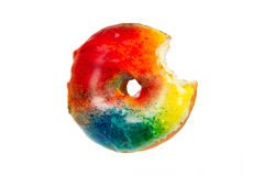 Colorful Donut with Bite Missing on White Stock Photos