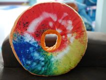 Colorful donut pillows. Can be used as pillows or bedspreads, or as a gift replacement for festivals royalty free stock images