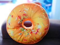 Colorful donut pillows stock image