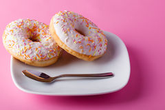 Colorful donut on pink background Stock Image