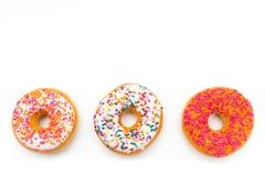 Colorful donut trio Stock Image