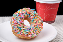 Colorful Donut in white plate and coffee with black background. Picture of Colorful Donut in white plate and coffee with black background Stock Photo
