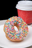 Colorful Donut in white plate and coffee with black background. Picture of Colorful Donut in white plate and coffee with black background Royalty Free Stock Photography