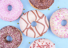 Colorful donuts on blue background. royalty free stock photo