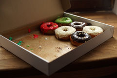 Colorful donuts in box Stock Images