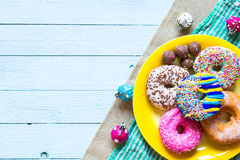 Colorful Donuts breakfast composition with different color styles stock image