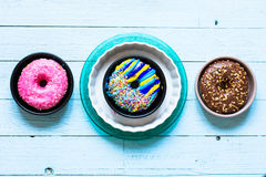 Colorful Donuts breakfast composition with different color styles royalty free stock photo