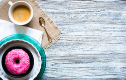 Colorful Donuts breakfast composition with different color styles. Of doughnuts over an aged wooden desk background stock photo