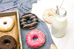 Colorful donuts with chocolate and icing Stock Images