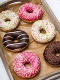 Colorful donuts with chocolate and icing, Stock Photo