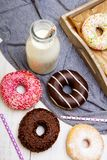 Colorful donuts with chocolate and icing, Royalty Free Stock Photography