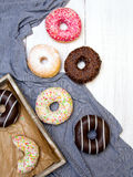 Colorful donuts with chocolate and icing Stock Photos