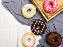 Colorful donuts with chocolate and icing Royalty Free Stock Photos