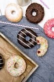 Colorful donuts with chocolate and icing, Royalty Free Stock Images